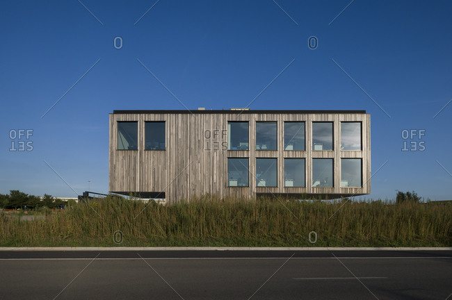 Ghent, Belgium - July 30, 2014: Rows of windows on modern office building seen from across roadway