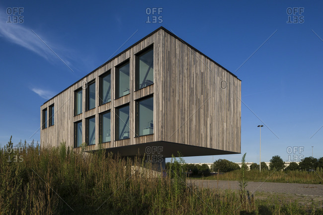 Ghent, Belgium - July 30, 2014: Modern office building with parking area below
