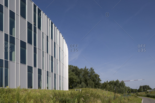 Ghent, Belgium - July 31, 2014: Rounded multistory modern office building
