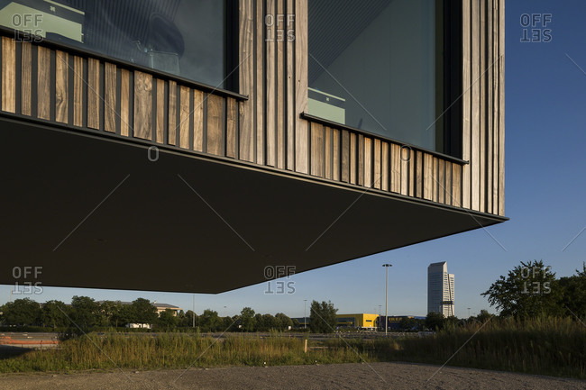 Ghent, Belgium - July 30, 2014: Low angle view of modern office building from parking area