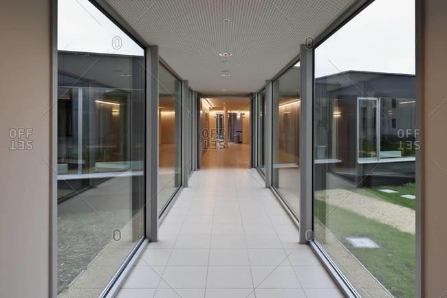 Hallway flanked by windows