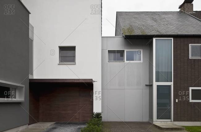 Driveways and parking spaces of two modern designed homes