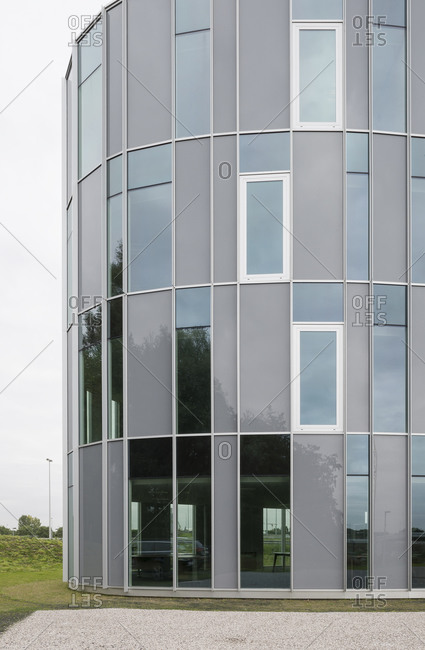 Ghent, Belgium - September 26, 2014: Rounded edge of building with rectilinear windows