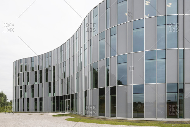 Ghent, Belgium - September 26, 2014: Exterior of curved building with rectilinear windows