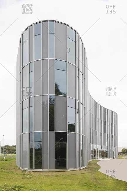 Ghent, Belgium - September 26, 2014: Gently curving organic-shaped building with rectilinear windows