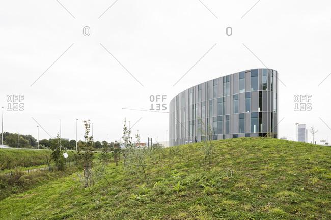 Ghent, Belgium - September 26, 2014: Modern building on hill adjacent to freeway