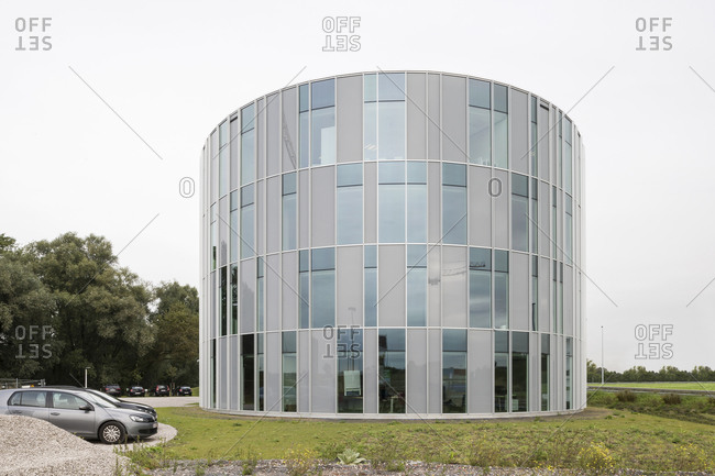 Ghent, Belgium - September 26, 2014: Circular side of office building and parking lot