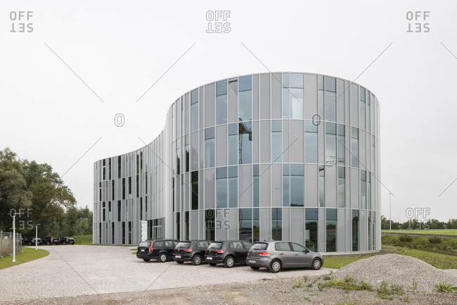Ghent, Belgium - September 26, 2014: Cars parked outside of organic-shaped office building