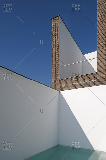 Walled pool of modern design house