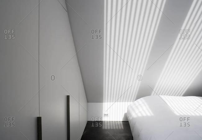 Light patterns on wall of modern bedroom interior