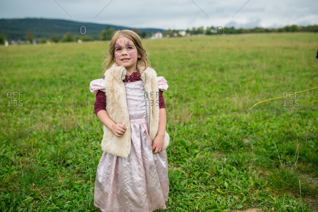 Girl in a costume standing in a field