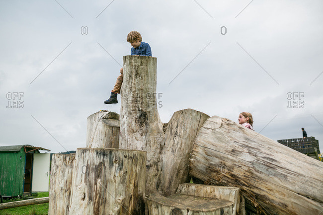 Kids climbing on giant logs