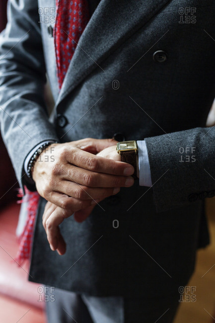 Midsection of businessman checking his watch