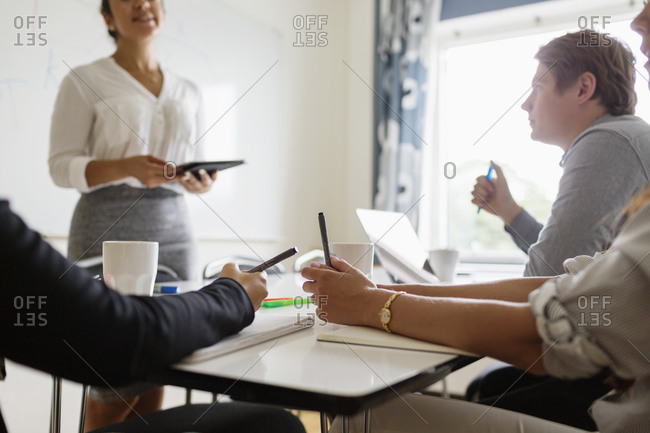 Woman leading her colleagues in a meeting