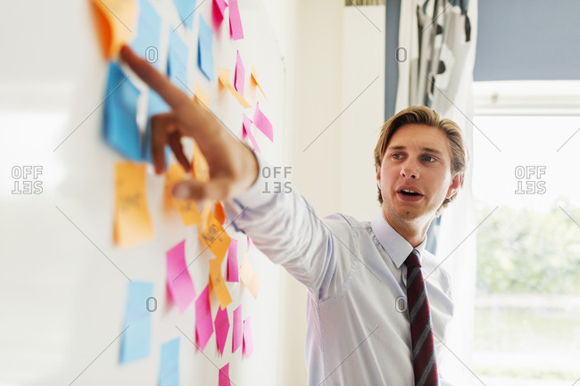 Man pointing to notes during a meeting