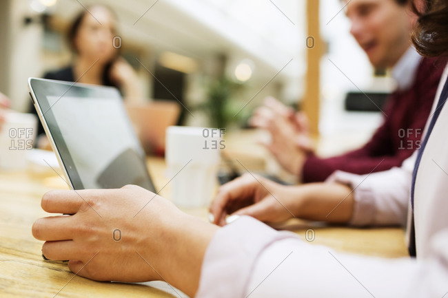 Close up of businesswoman's hands by laptop