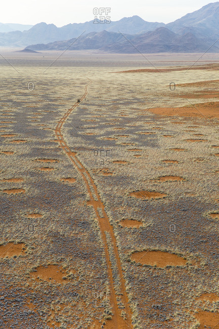 Land Rover on deserted track in the Namib Desert, Namibia, Africa