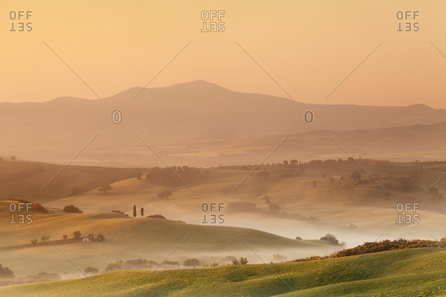 Sunrise at Val d'Orcia, near San Quirico, Val d'Orcia (Orcia Valley), UNESCO World Heritage Site, Siena Province, Tuscany, Italy