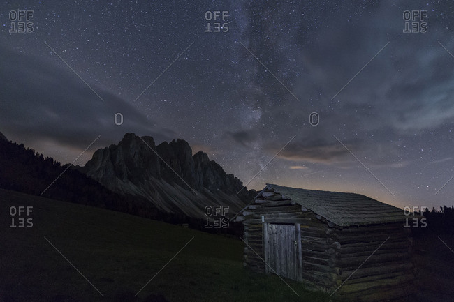The Milky Way in the starry sky above the Odle, Funes Valley, South Tyrol, Dolomites, Italy