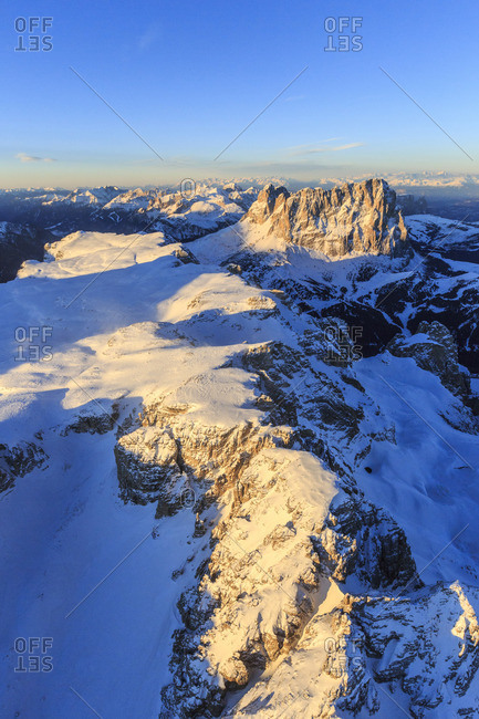 Aerial view of Sassolungo and Grohmann peaks at sunset, Sella Group, Dolomites, Trentino-Alto Adige, Italy