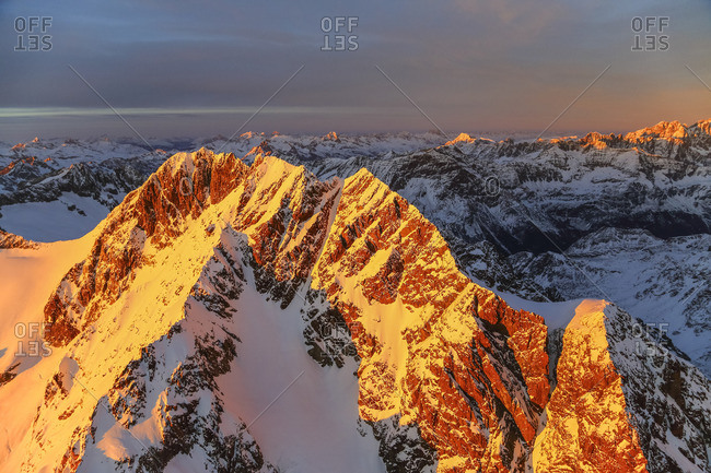 Aerial view of Mount Disgrazia and Bernina Group at sunset, Masino Valley, Valtellina, Lombardy, Italy