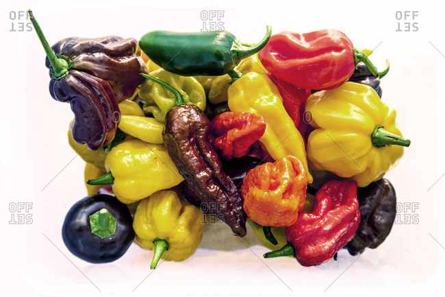 A variety of peppers in a cluster