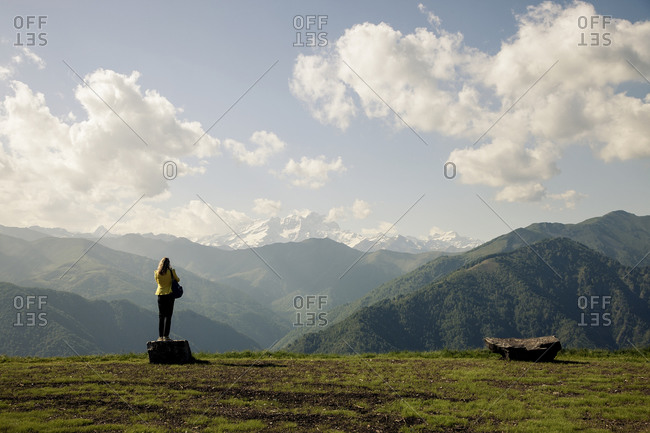 Woman standing on an Italian mountaintop