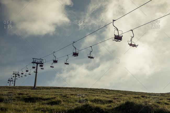 Ski lift in summer in Italian mountain