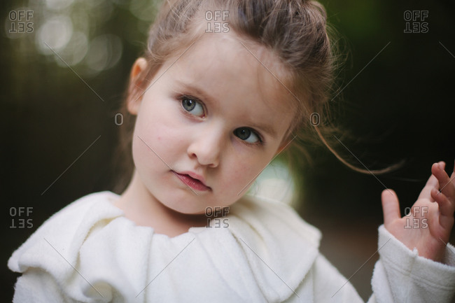 Little girl in white coat close up