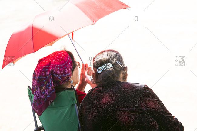 Navajo Elders under umbrella, Navajo Nation Fair, Navajo Nation, Window Rock, AZ, USA