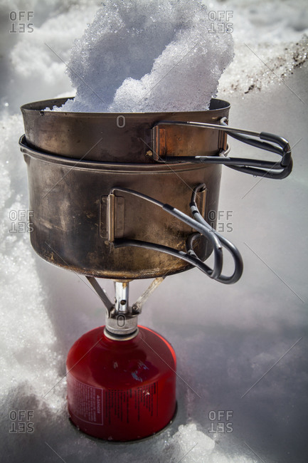 A stove melts snow for water at Camp Muir in Mount Rainier National Park, Washington, USA