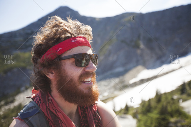 Portrait of a hiker wearing a bandana and sporting a thick beard