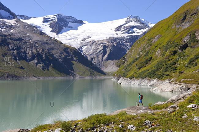 A male hiker near the Mooserboden lake, during the Glocknerrunde
