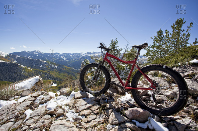 A fat tire bike leans upon a rock high up in the Wasatch Mountains, Utah