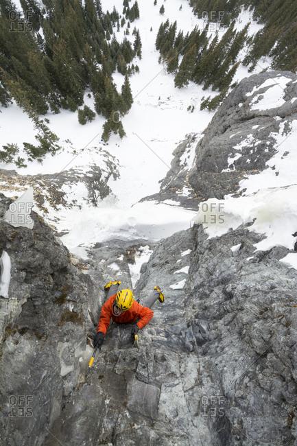 A man ice climbing a route called The Talisman along the Camp Bird Road near Ouray, Colorado