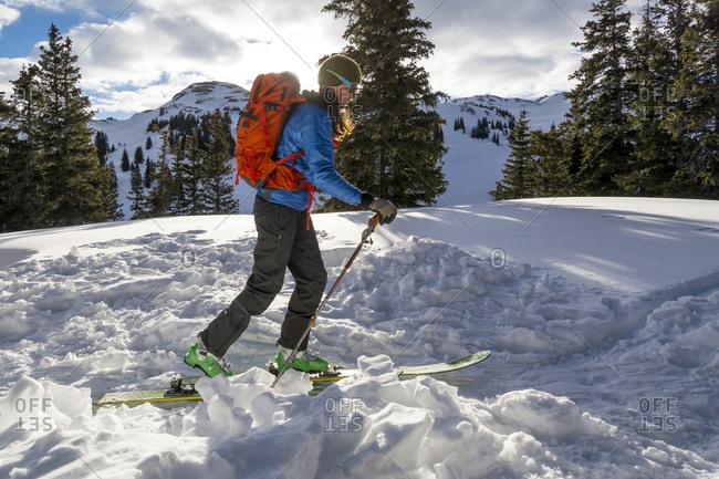 A woman backcountry skiing on Red Mountain Pass, Silverton, Colorado