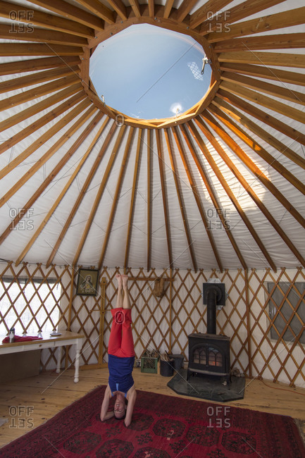 A woman doing yoga in a yurt in Mayday, Colorado