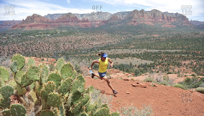 Woman runs the Cathedral Rock Trail