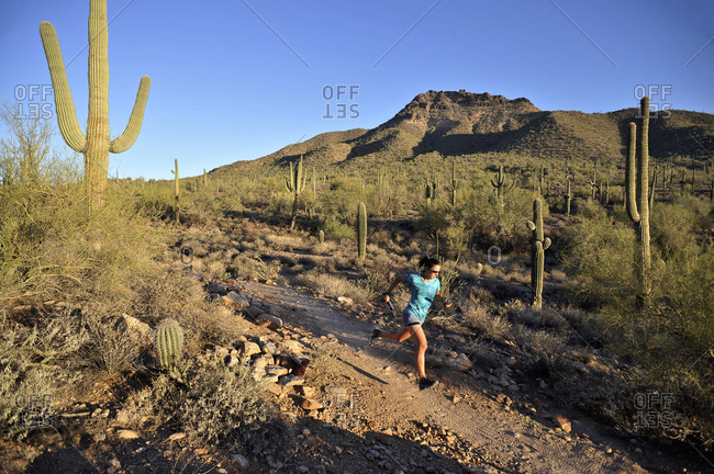 Woman trail running in Usery Mountain Park