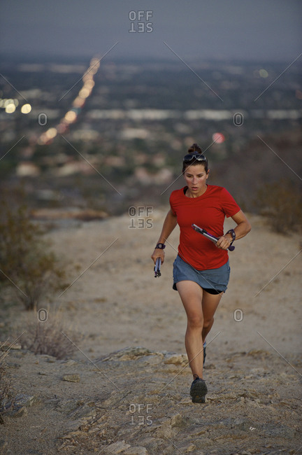 Woman trail running in South Mountain Park