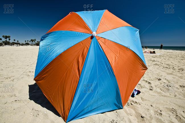 A colorful umbrella on the beach in Long Beach, California