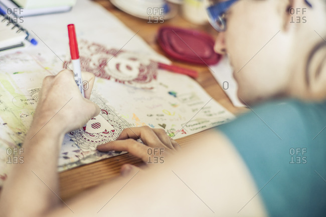 An artist working on a drawing at a home office