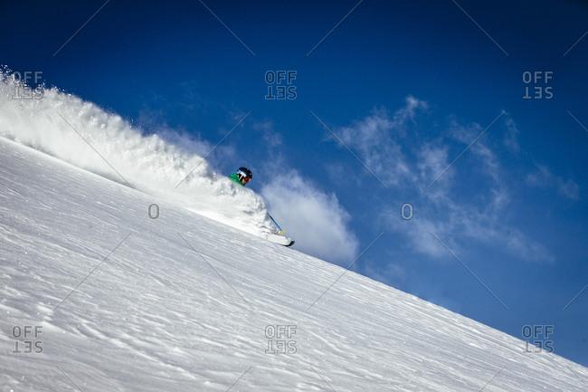 A man skiing fresh snow on a sunny day Alta, Utah