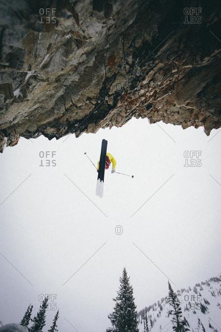 A man skiing of at cliff at Alta, Utah