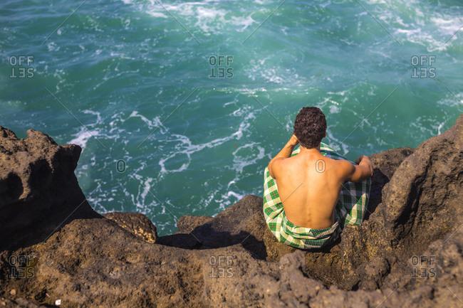 Young man near the ocean Bali, Indonesia