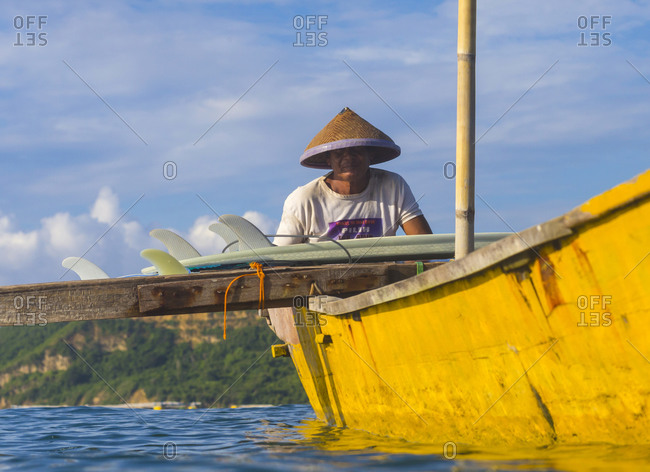Asian man in boat Bali, Indonesia