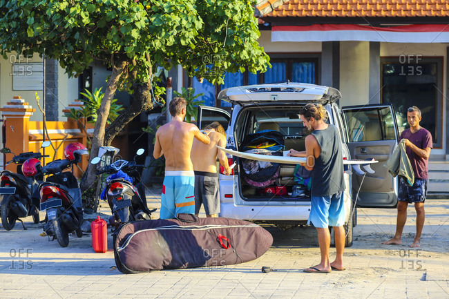 Surfers  Getting Ready to Ride the Surf