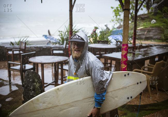 Surfer under a rain, Bali, Indonesia