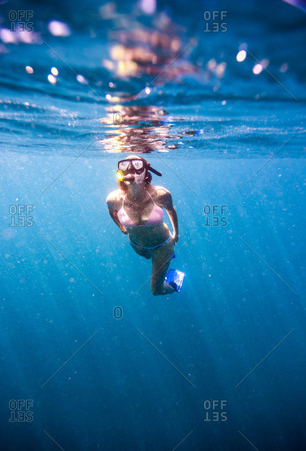 Young woman snorkeling in ocean