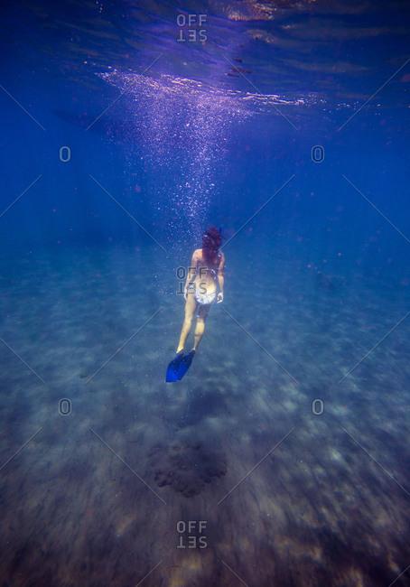 Young woman snorkeling in ocean